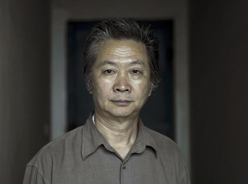 In this photo taken Saturday, May 4, 2013 and made available Tuesday, Nov. 26, 2013, Chen Keyun poses for a picture at his home a day after the Fujian Provincial Higher People's Court acquitted him of guilt in the 2001 bombing of a Communist Party office in Fuqing city in southeast China's Fujian province. Chen denied committing the crime but was held for 12 years, during which he was tortured into confession and twice sentenced to death, in a case that exemplifies the miscarriage of justice that China's Supreme People's Court now says it wants to curtail. (AP Photo) CHINA OUT