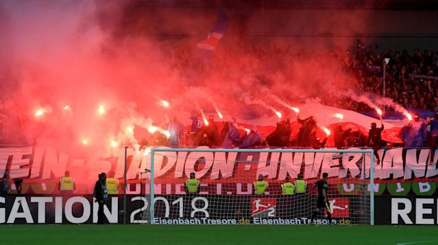 Soccer Football - Bundesliga Promotion/Relegation Playoff Second Leg - Holstein Kiel vs VfL Wolfsburg - Holstein-Stadion, Kiel, Germany - May 21, 2018 Holstein Kiel fans light flares before the match REUTERS/Fabian Bimmer DFL RULES TO LIMIT THE ONLINE USAGE DURING MATCH TIME TO 15 PICTURES PER GAME. IMAGE SEQUENCES TO SIMULATE VIDEO IS NOT ALLOWED AT ANY TIME. FOR FURTHER QUERIES PLEASE CONTACT DFL DIRECTLY AT + 49 69 650050