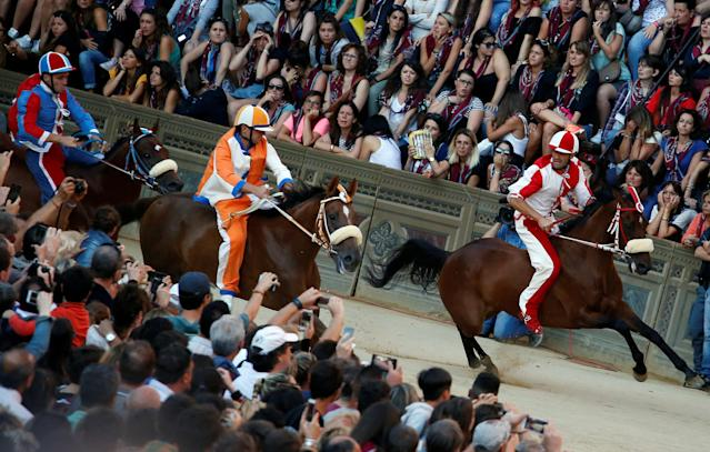 "Jockey Jonatan Bartoletti of ""Giraffa"" (Giraffe) parish leads during the second practices for the Palio of Siena, Italy July 1, 2017. REUTERS/Stefano Rellandini"