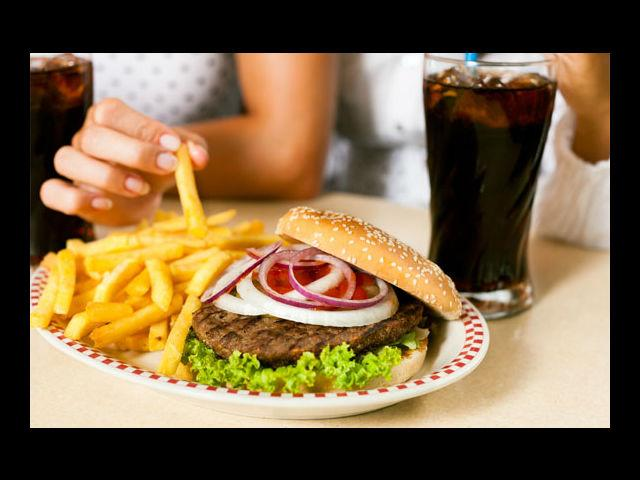"""<b>Fried Food</b><br><p> French fries, chips and dumplings are certainly a treat to the taste buds. These <a href=""""http://www.mensxp.com/health/live-healthy/7136-things-you-must-know-about-fried-foods.html"""">fried foods</a>  contain fractionated oils, which can injure the free radicals in your  skin, which ultimately leads to premature aging. The fat also makes it  difficult for the nutrients to be absorbed by the membranes that can  lead to poor circulation in your skin and be the source of acne.</p>"""