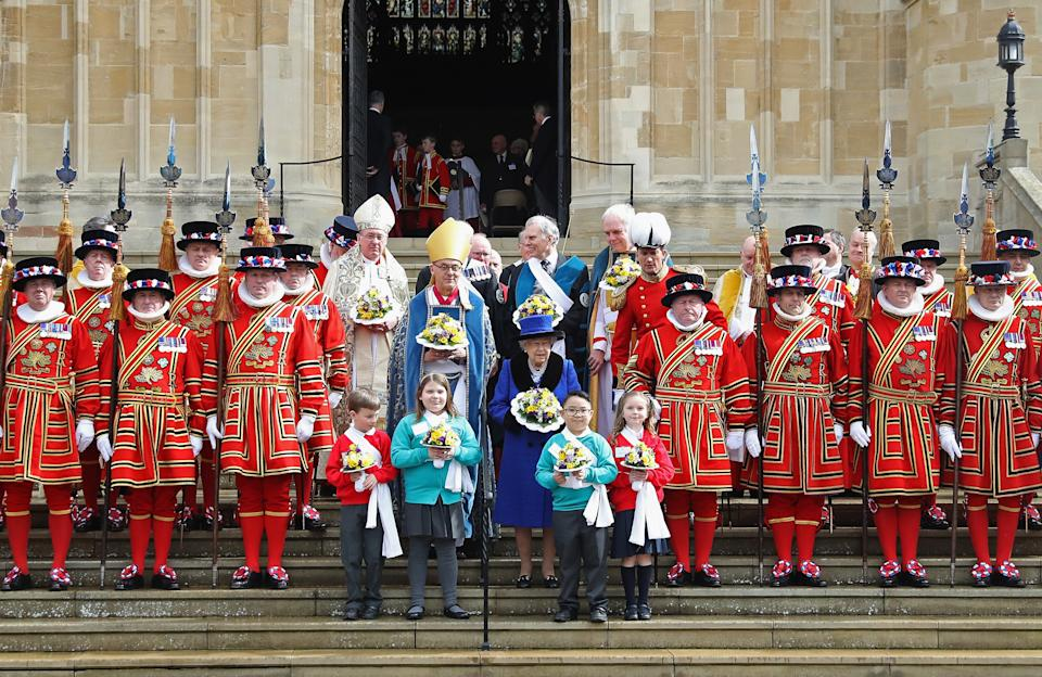 WINDSOR, ENGLAND - MARCH 29:  Queen Elizabeth II poses with Yeomen of the Guard after attending the Royal Maundy Service at St George's Chapel on March 29, 2018 in Windsor, England.  (Photo by Chris Jackson/Getty Images)