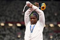 <p>Second-placed USA's Raven Saunders gestures on the podium with her silver medal after competing the women's shot put event during the Tokyo 2020 Olympic Games at the Olympic Stadium in Tokyo on August 1, 2021. (Photo by Ina FASSBENDER / AFP) (Photo by INA FASSBENDER/AFP via Getty Images)</p>