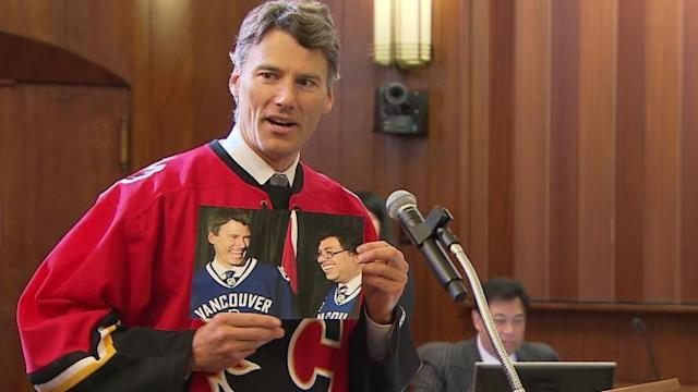 Gregor Robertson loses bet, wears Calgary Flames jersey, reads poem by Naheed Nenshi