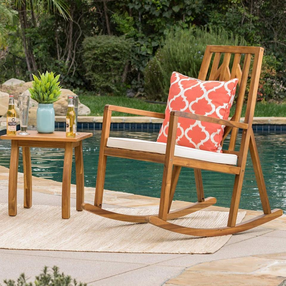 <p>Rock yourself into ultimate relaxation with the <span>Nuna Acacia Wood Patio Rocking Chair Set</span> ($190).</p>