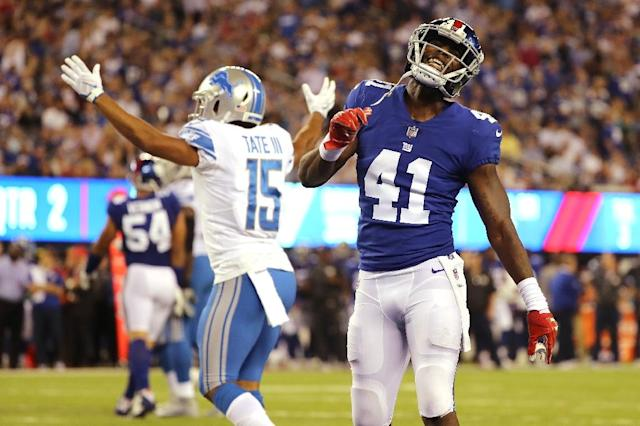 Dominique Rodgers-Cromartie (R) of the New York Giants reacts against Golden Tate of the Detroit Lions during their game at MetLife Stadium on September 18, 2017 in East Rutherford, New Jersey (AFP Photo/Abbie Parr)