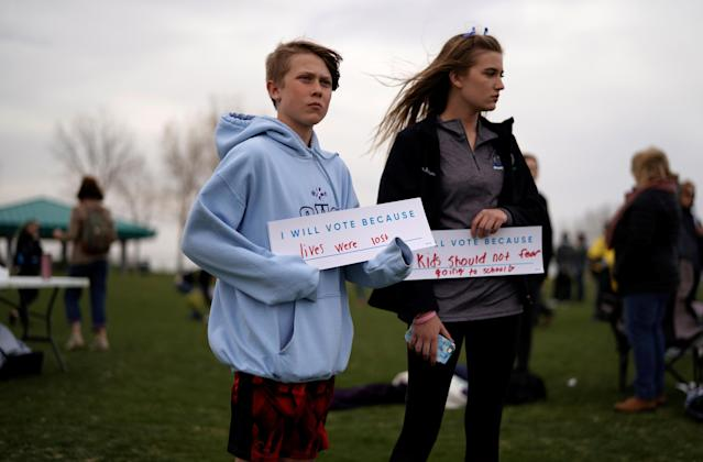 Quin Coppedge, left, and Joni Coppedge attend a voter registration rally coinciding with the 19th anniversary of the Columbine (Colo.) High School shooting. (Photo: Rick Wilking/Reuters)