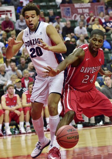 Gonzaga forward Elias Harris goes for a loose ball against Davidson forward De'Mon Brooks during the first half of an NCAA college basketball game at the Old Spice Classic in Kissimmee, Fla., Sunday, Nov. 25, 2012. (AP Photo/Roberto Gonzalez)