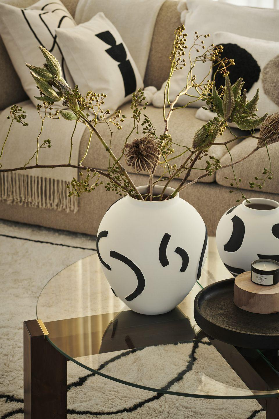 """<p>Hit refresh on your living room accessories with H&M Home's new scene-stealing ceramic vases, available in a range of sizes. </p><p><strong>HB recommends... </strong>To create a stunning centrepiece, fill your vase with artificial blooms, dried foliage or pampas grass. They will last much longer than fresh flowers. </p><p><a class=""""link rapid-noclick-resp"""" href=""""https://go.redirectingat.com?id=127X1599956&url=https%3A%2F%2Fwww2.hm.com%2Fen_gb%2Fhome.html&sref=https%3A%2F%2Fwww.housebeautiful.com%2Fuk%2Flifestyle%2Fshopping%2Fg35116386%2Fhandm-home-spring%2F"""" rel=""""nofollow noopener"""" target=""""_blank"""" data-ylk=""""slk:SHOP H&M HOME"""">SHOP H&M HOME</a> </p>"""
