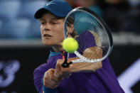 Italy's Jannik Sinner makes a backhand return to Canada's Denis Shapovalov during the first round match at the Australian Open tennis championship in Melbourne, Australia, Monday, Feb. 8, 2021. (AP Photo/Rick Rycroft)
