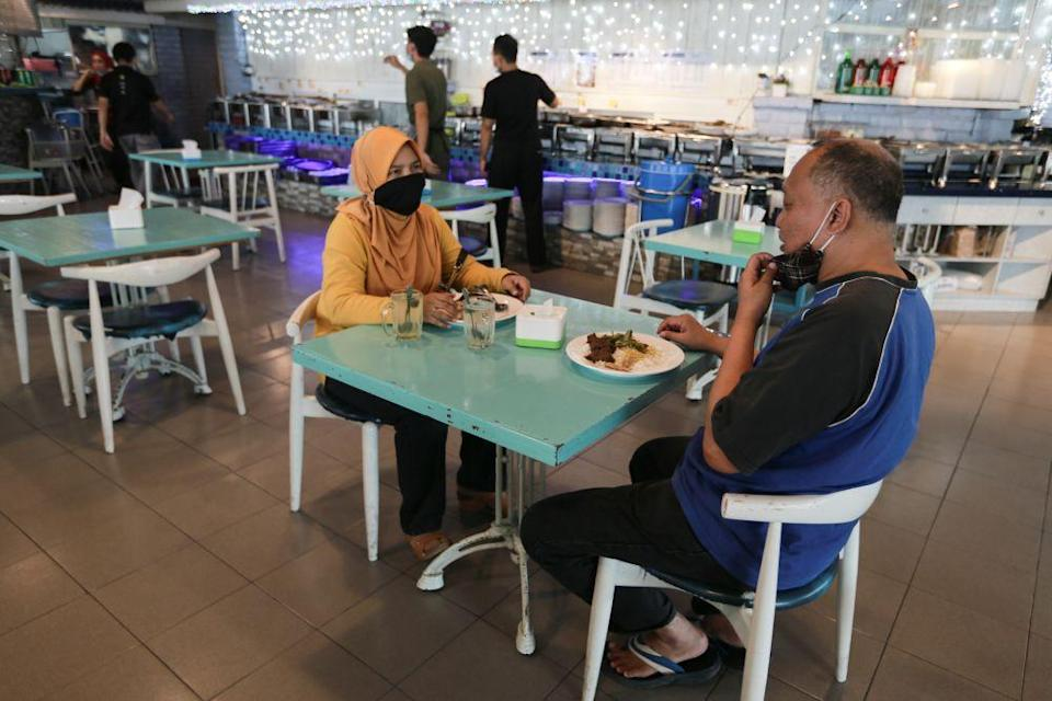 People are seen dining at a restaurant in Selangor as the conditional movement control order kicks in October 14, 2020. — Picture by Ahmad Zamzahuri