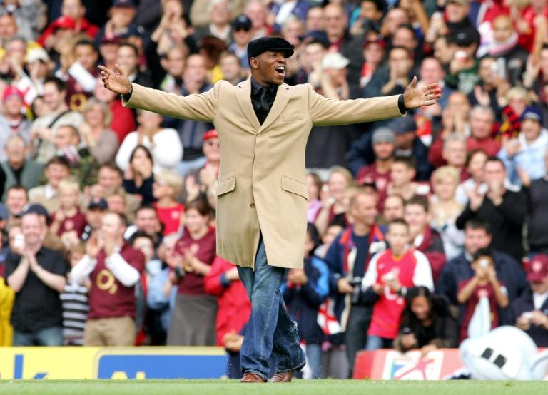 Former Arsenal player Ian Wright acknowledges the fans before the Premier League match between his former side and Manchester United at Arsenal's then ground at Highbury, north London on October 22, 2005