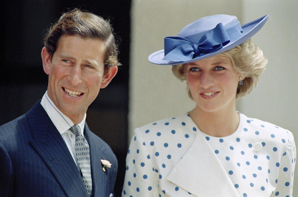 """FILE - This Nov. 7, 1985 file photo shows Britain's Prince Charles with his wife Princess Diana in front of Lodge Canberra, Australia. It has been 20 years since the death of Princess Diana in a car crash in Paris and the outpouring of grief that followed the death of the """"people's princess.""""  (AP Photo, File)"""