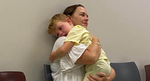 A photo of Candis holding Knox at their last MRI appointment. Source: supplied