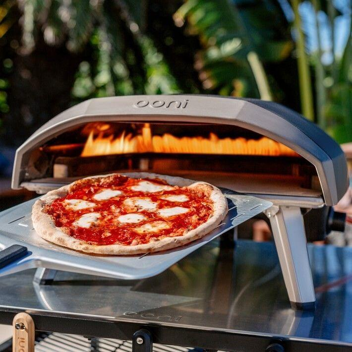"""Fromrolling out the dough and adding toppings to watching it cook over the flame, you'll enjoy the whole process.<br /><br /><strong>Promising review:</strong>""""We've wanted a pizza oven for a long time. The regular oven only gets to about 550F and the BBQ doesn't cook the top of the pizza well enough. Then this amazing thing comes along. It delivers as promised. Read to launch pizzas in 20 minutes. In fact I found that lower than max temp worked perfectly and avoided the over-charred crust. The 16-inch size is nice to allow room to maneuver 12-13"""" pies around to cook them evenly. I used the provided dough recipe with success so far. I look forward to trying some other crust types. I<strong>f you are on the fence about this, listen: Buy it!</strong>Nothing easier than gas. Pizzas on my second try came as good as the best restaurant pizzas I've had. Keep the toppings light and you will love it too."""" —<a href=""""https://go.skimresources.com?id=38395X987171&xs=1&url=https%3A%2F%2Fwww.williams-sonoma.com%2Fproducts%2Fooni-koda-16-pizza-oven%2F&xcust=HPWantedKitchenGadgets6087326be4b09a22a4461b8c"""" target=""""_blank"""" rel=""""noopener noreferrer"""">matthekman</a><br /><br /><strong>Get it from Williams-Sonoma for <a href=""""https://go.skimresources.com?id=38395X987171&xs=1&url=https%3A%2F%2Fwww.williams-sonoma.com%2Fproducts%2Fooni-koda-16-pizza-oven%2F&xcust=HPWantedKitchenGadgets6087326be4b09a22a4461b8c"""" target=""""_blank"""" rel=""""noopener noreferrer"""">$499.95</a>.</strong>"""