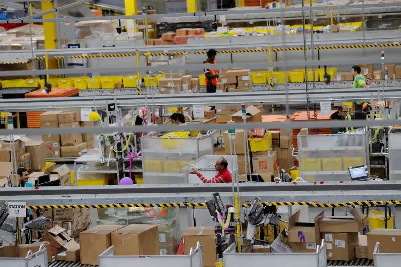 FILE PHOTO: FILE PHOTO: Amazon workers perform their jobs inside of an Amazon fulfillment center on Cyber Monday in Robbinsville, New Jersey