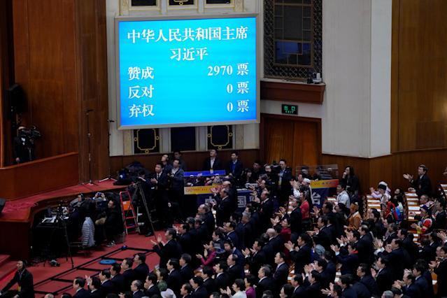 Voting results of Chinese President Xi Jinping voted as the president for another term, is seen on a screen at the fifth plenary session of the National People's Congress (NPC) at the Great Hall of the People in Beijing, China March 17, 2018. REUTERS/Jason Lee TPX IMAGES OF THE DAY