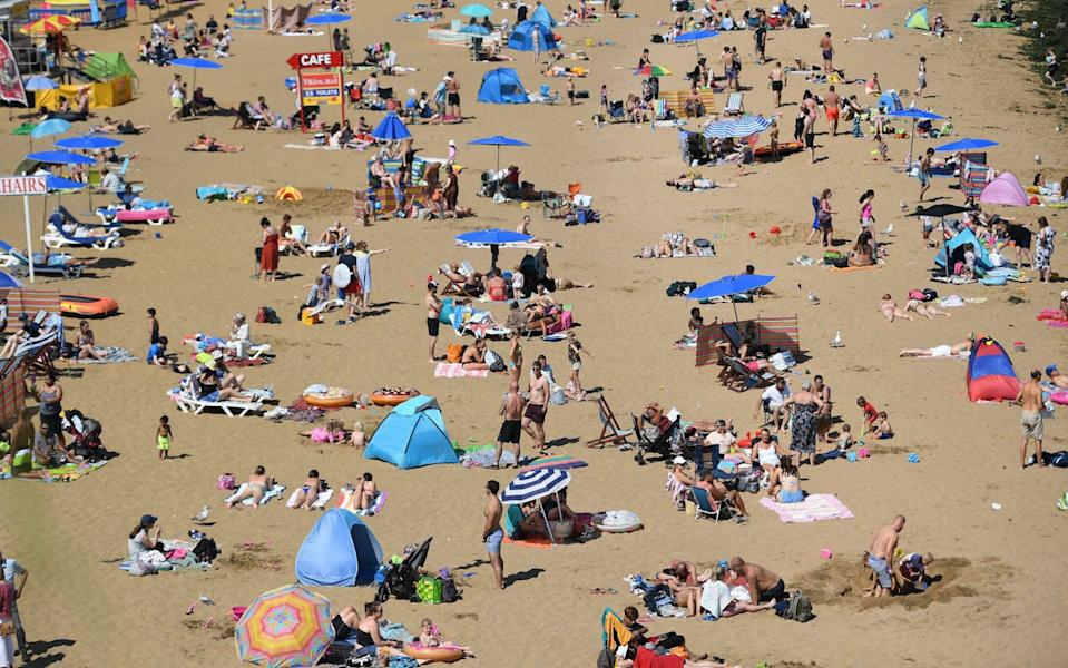 Holidaymakers soak up sun at Broadstairs, Kent. Many people are booking their summer or autumn breaks in the UK - Andy Rain/EPA-EFE/Shutterstock