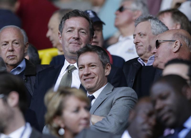 Noted Arsenal fan and CNN talk show host Piers Morgan in the crowd as he wait to watch the English Premier League soccer match between Tottenham Hotspur and Arsenal at White Hart Lane stadium in London, Sunday, March 16, 2014