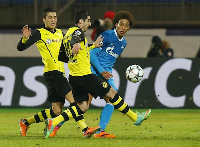 Zenit's Axel Witsel, right, is blocked by Borussia's Henrikh Mkhitaryan, center, and Nuri Sahin, left, during the Champions League soccer match between Zenit St.Petersburg and Borussia Dortmund at Petrovsky stadium in St.Petersburg, Russia, on Tuesday, Feb. 25, 2014. (AP Photo/Dmitry Lovetsky)