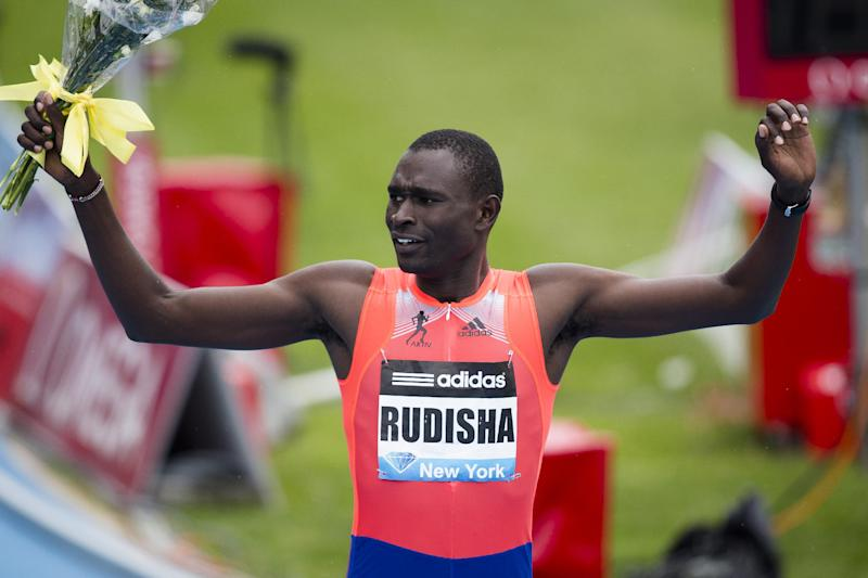 David Rudisha, representing Kenya, celebrates winning the Men's 800m during the IAAF Diamond League Grand Prix competition on Randall's Island, Saturday, May 25, 2013, in New York. (AP Photo/John Minchillo)