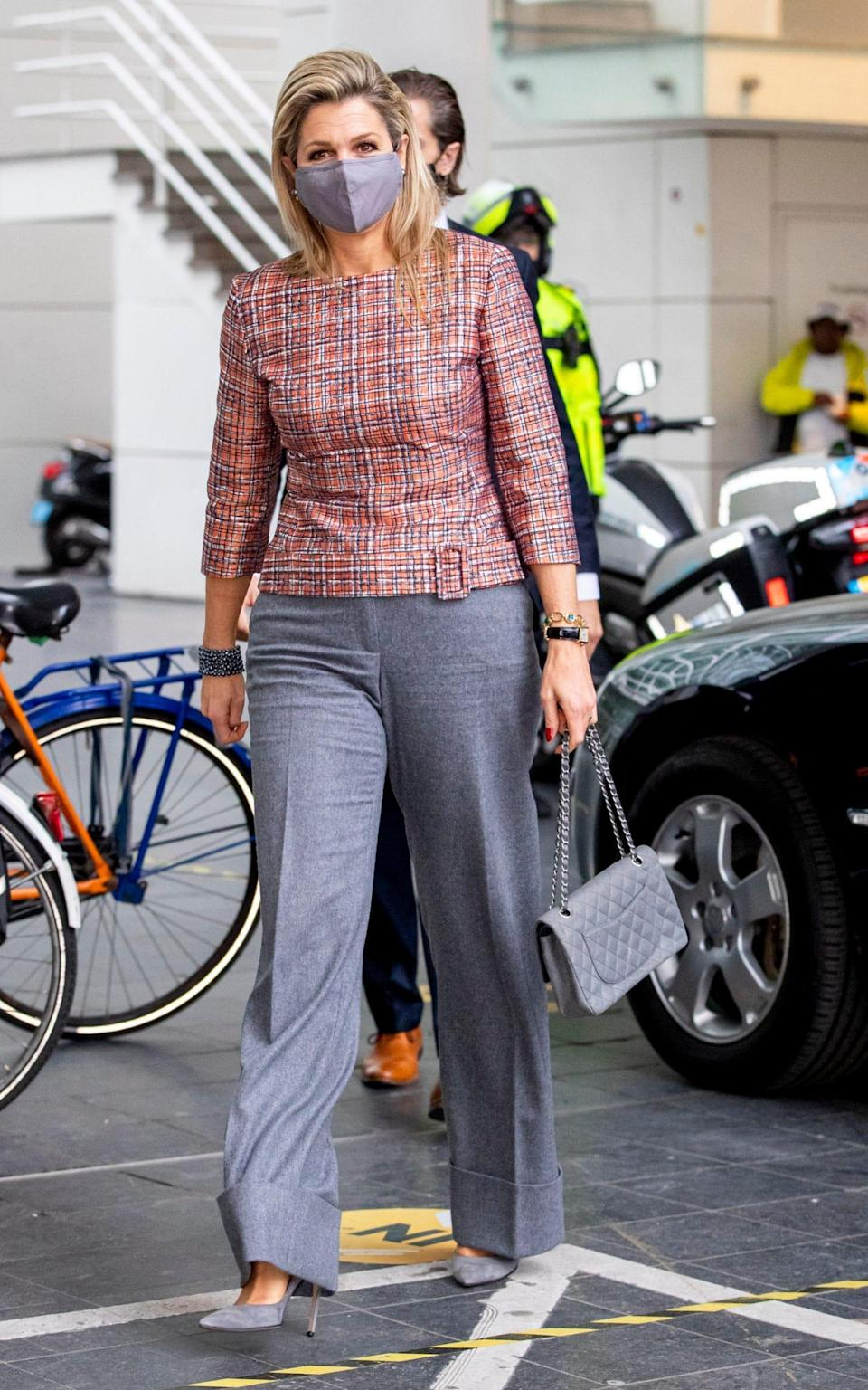 Queen Maxima wearing an elegant pair of grey trousers - Getty