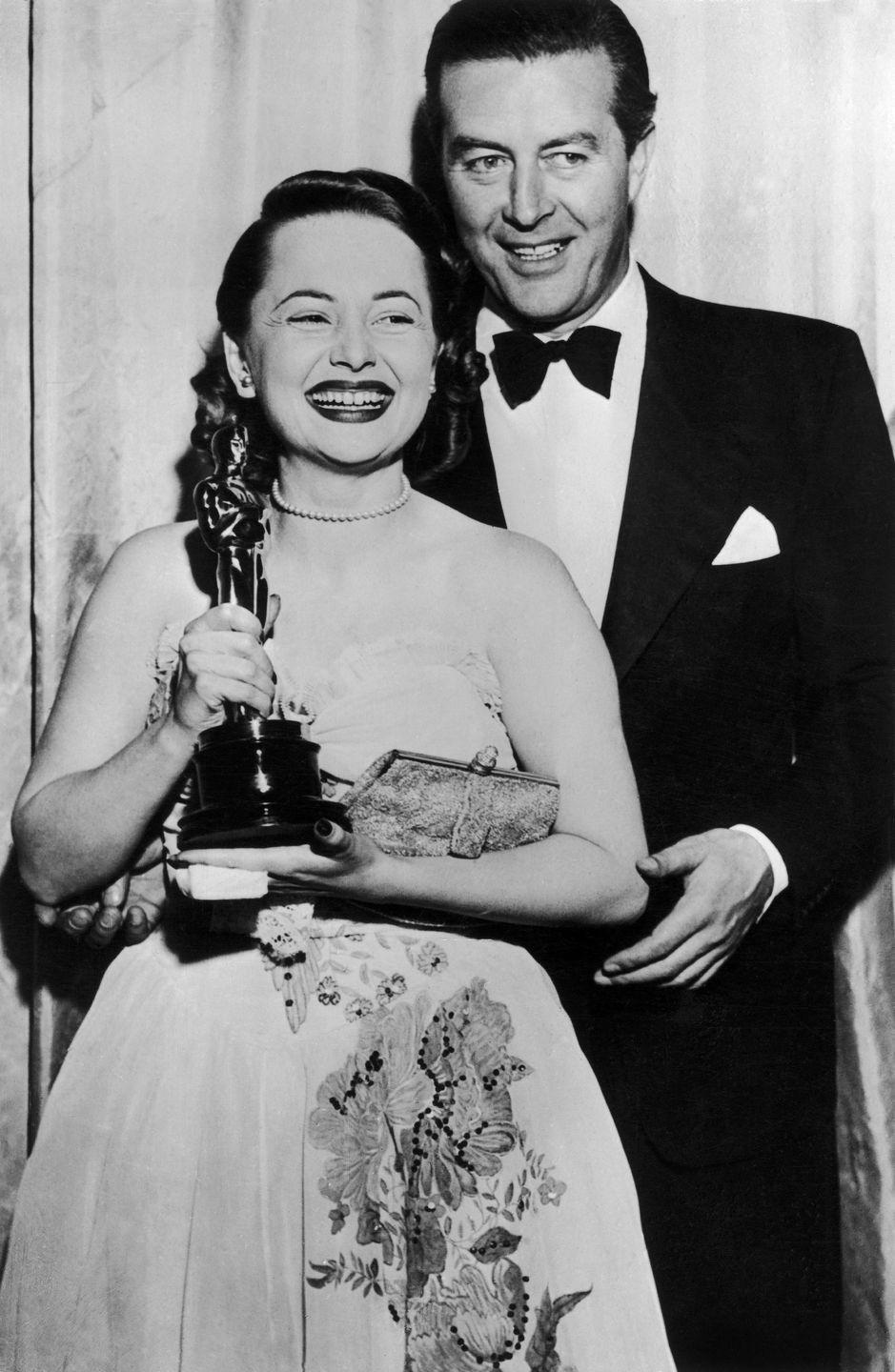 <p>Olivia de Havilland just moments after receiving the Best Actress Oscar from actor Ray Milland in 1947.</p>