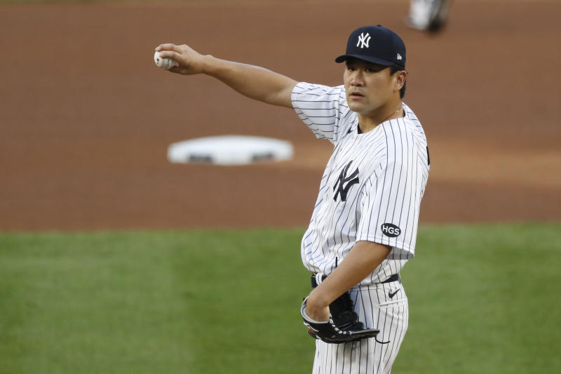 New York Yankees starting pitcher Masahiro Tanaka stretches out his arm before warming up before the start of a baseball game, Tuesday, Aug. 18, 2020, in New York. (AP Photo/Kathy Willens)