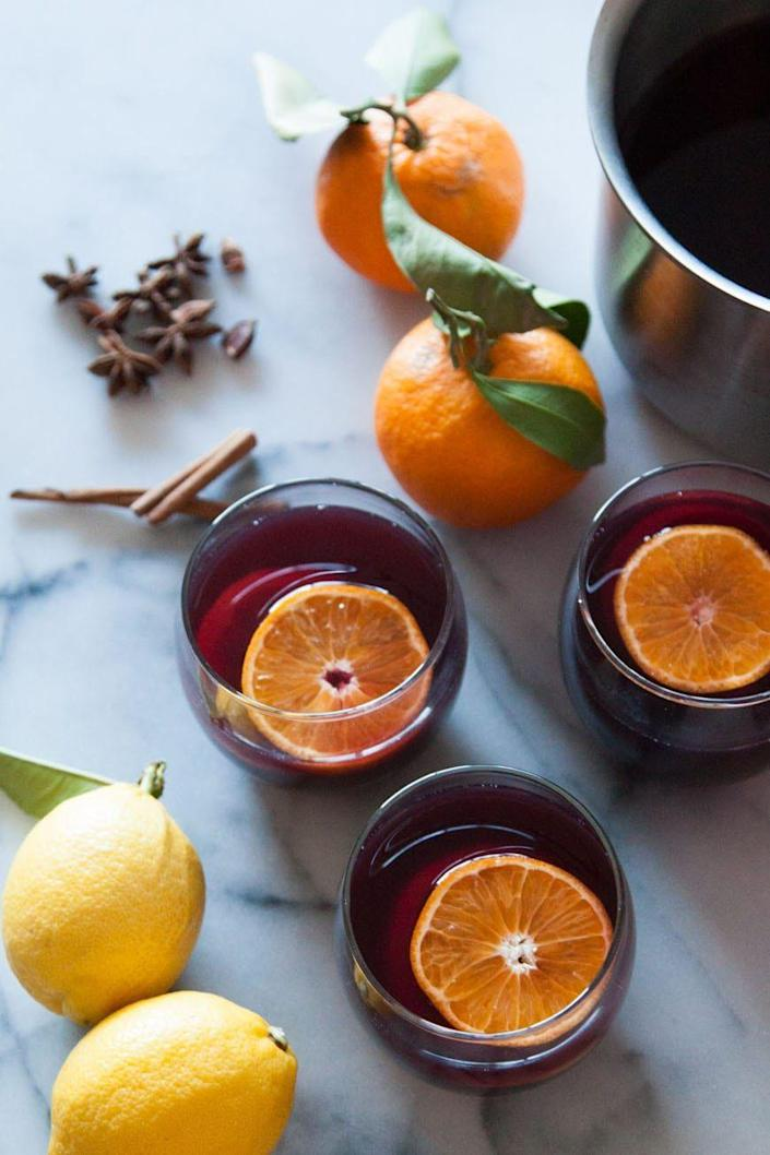 """<p>Bring wine and apple cider together in this warm drink. A bit of citrus and some spices make it an irresistible sip.</p><p><strong>Get the recipe at <a href=""""https://whatsgabycooking.com/spiced-wine/"""" rel=""""nofollow noopener"""" target=""""_blank"""" data-ylk=""""slk:What's Gaby Cooking"""" class=""""link rapid-noclick-resp"""">What's Gaby Cooking</a>.</strong> </p>"""