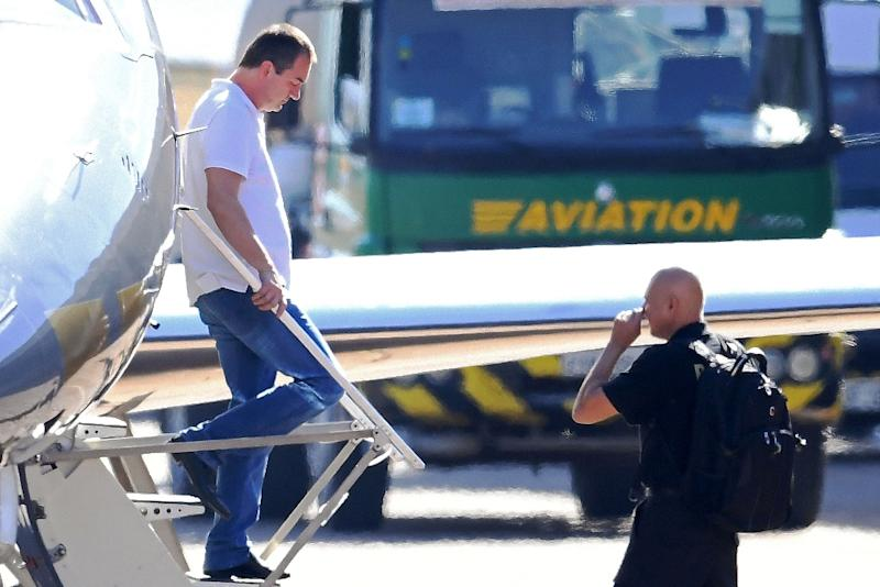 Former JBS chairman Joesley Batista (L) disembarks from a Brazilian Federal Police airplane at Brasilia's International Airport on September 11, 2017