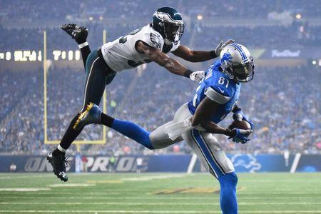 Nov 26, 2015; Detroit, MI, USA; Detroit Lions wide receiver Calvin Johnson (81) scores a touchdown while being pressured by Philadelphia Eagles cornerback Eric Rowe (32) during the third quarter of a NFL game on Thanksgiving at Ford Field. Mandatory Credit: Tim Fuller-USA TODAY Sports