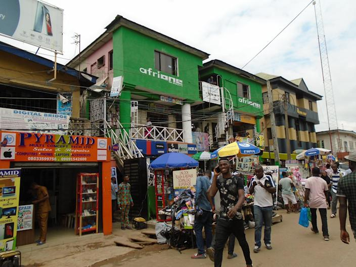 A building painted in AfriOne's brand colors in the Computer Village market, Lagos, Nigeria. The market, which occupies a ramshackle-looking gated neighborhood near Lagos's international airport, is the center of the country's consumer electronics trade. (Photo: Armin Rosen for Yahoo News)