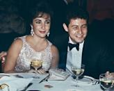 <p>Renowned for her impressive jewelry collection, La Liz wore a crystal beaded dress and statement earrings for a dinner with then-husband Eddie Fisher in 1959.</p>