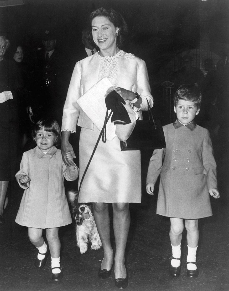 <p>Sarah, almost 2 years old here, holds her mother Princess Margaret's hand while arriving for an event in London with brother Linley (right).</p>