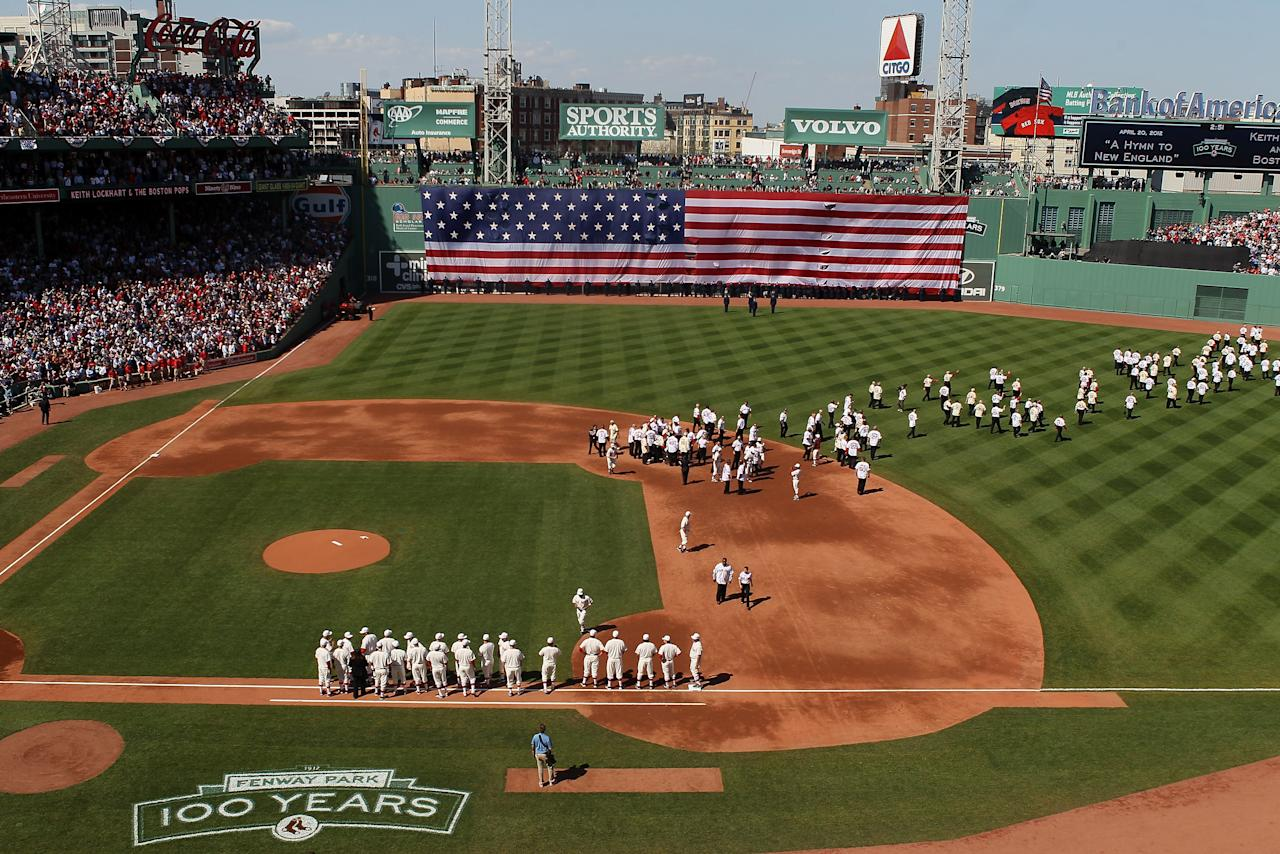 BOSTON, MA - APRIL 20:  Current and former Red Sox players, coaches and managers stand on the field before the game between the New York Yankees and the Boston Red Sox on April 20, 2012 at Fenway Park in Boston, Massachusetts. Today marks the 100 year anniversary of the ball park's opening.  (Photo by Elsa/Getty Images)