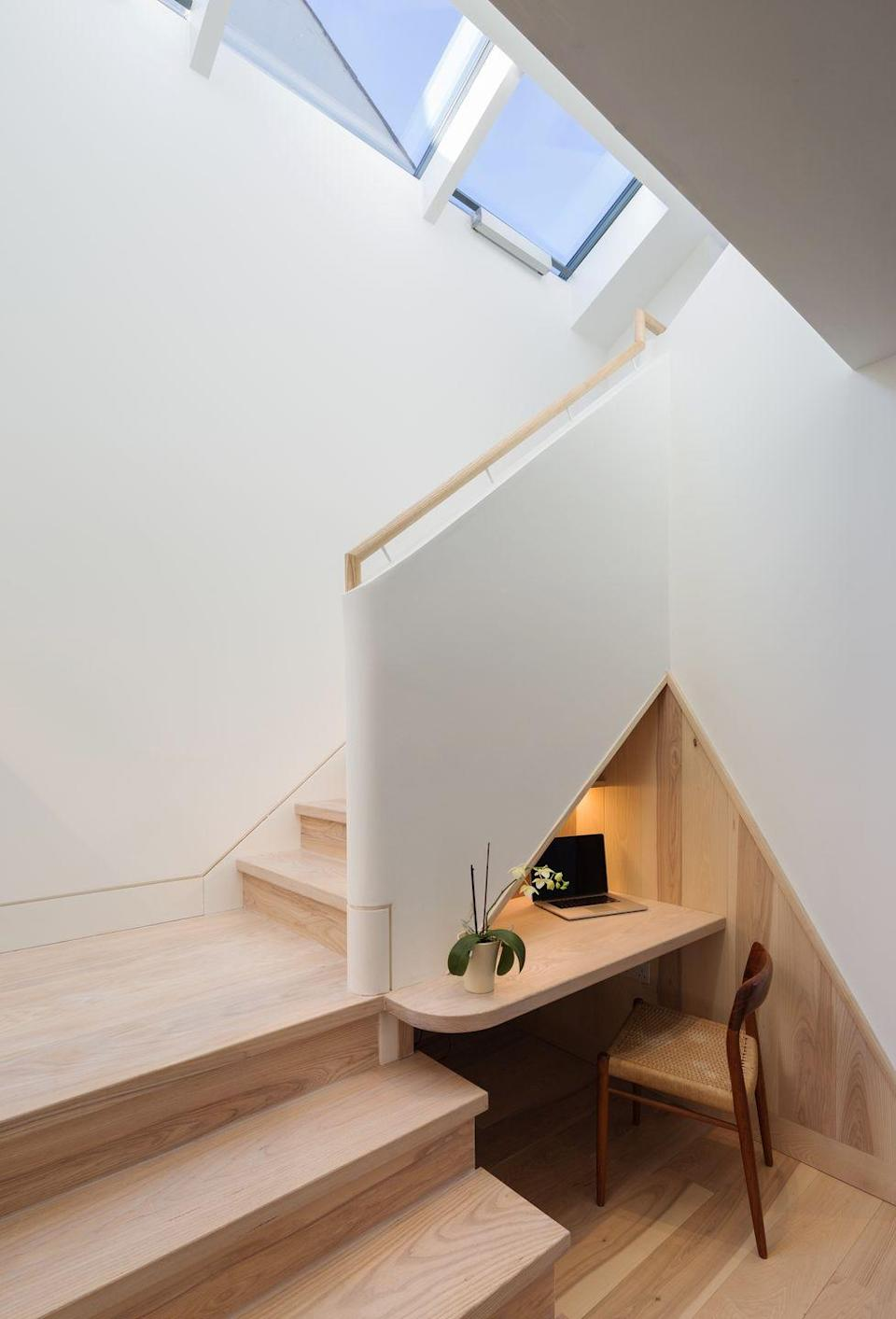 """<p>Cut into the small slice of space beneath this new staircase, and lit from above by a generous skylight, this is the ideal work-from-home nook. It's part of a family home designed by Cambridge-based Mole Architects, which last year picked up three RIBA Awards, including the main prize for innovative local housing scheme Marmalade Lane. <a href=""""https://www.molearchitects.co.uk/"""" rel=""""nofollow noopener"""" target=""""_blank"""" data-ylk=""""slk:molearchitects.co.uk"""" class=""""link rapid-noclick-resp"""">molearchitects.co.uk</a></p>"""