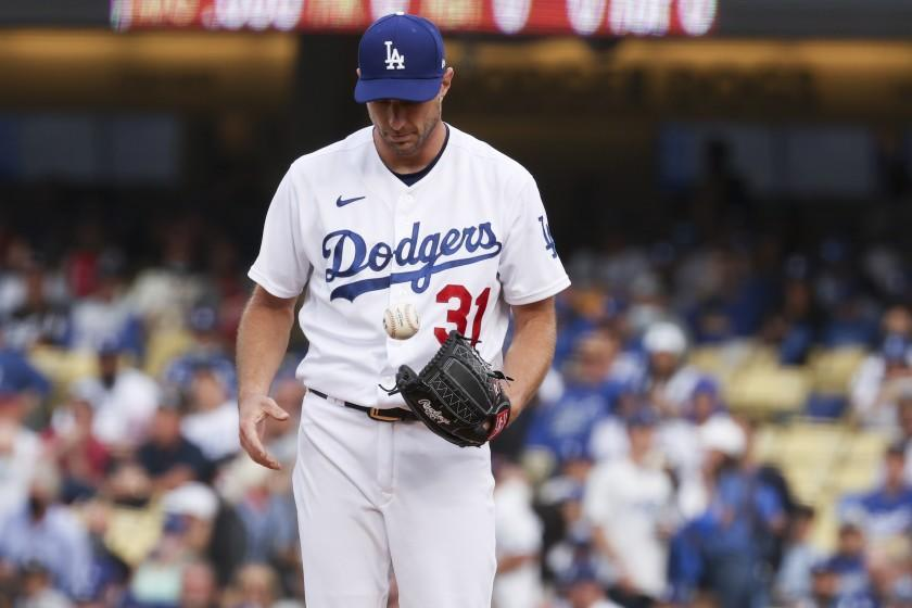 Los Angeles, CA - October 06: Los Angeles Dodgers starting pitcher Max Scherzer tosses the baseball while on the mound during the first inning against the St. Louis Cardinals at Dodger Stadium on Wednesday, Oct. 6, 2021 in Los Angeles, CA. (Robert Gauthier / Los Angeles Times)