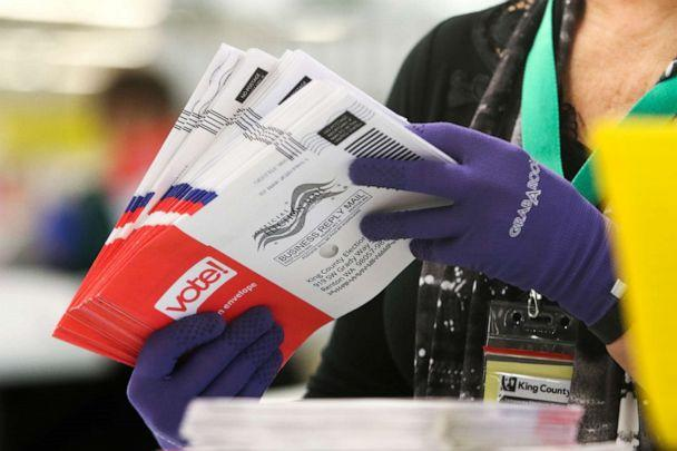PHOTO: An election workers sorts vote-by-mail ballots for the presidential primary at King County Elections in Renton, Washington on March 10, 2020. (Jason Redmond/AFP via Getty Images)