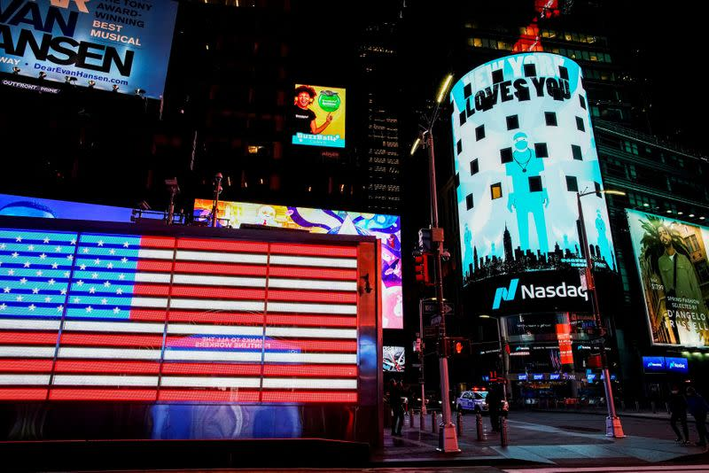 """FILE PHOTO: Times Square is illuminated in blue as part of the """"Light It Blue"""" initiative to honor healthcare workers, during the outbreak of the coronavirus disease (COVID-19) in New York"""
