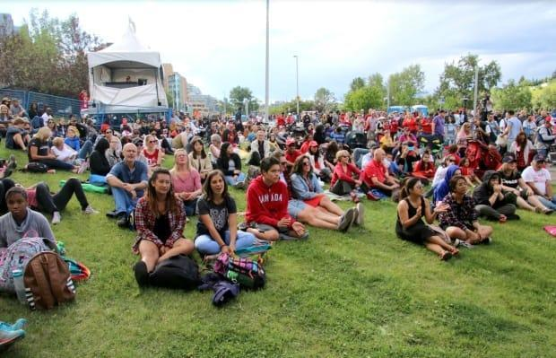 A crowd forms for the Canada Day concerts on Calgary's Riverfront Avenue in 2018. The province plans to lift virtually all of its COVID-19 public health restrictions on July 1. (Anis Heydari/CBC - image credit)