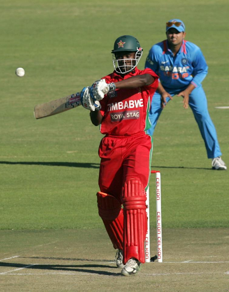 Zimbabwe batsman Elton Chigumbura in action during the second one-day international ODI series between hosts Zimbabwe and India at Harare Sports Club on July 26, 2013. AFP PHOTO / Jekesai Njikizana.        (Photo credit should read JEKESAI NJIKIZANA/AFP/Getty Images)
