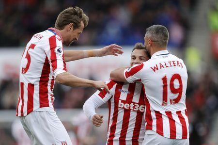 Britain Soccer Football - Stoke City v Hull City - Premier League - bet365 Stadium - 15/4/17 Stoke City's Xherdan Shaqiri celebrates scoring their third goal with Jonathan Walters and Peter Crouch Action Images via Reuters / Carl Recine Livepic