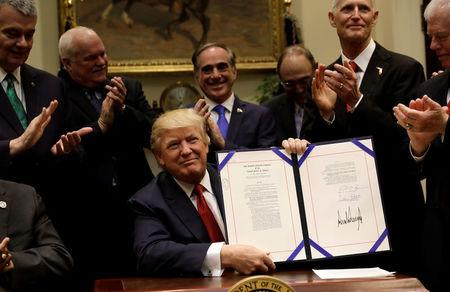 U.S. President Donald Trump smiles after signing S.544, the Veterans Choice Program Extension and Improvement Act, at the White House in Washington, U.S., April 19, 2017. REUTERS/Kevin Lamarque