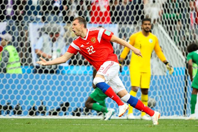 <p>Artem Dzyuba of Russia celebrates after scoring his sides third goal during the 2018 FIFA World Cup Russia group A match between Russia and Saudi Arabia at Luzhniki Stadium on June 14, 2018 in Moscow, Russia. (Getty Images) </p>