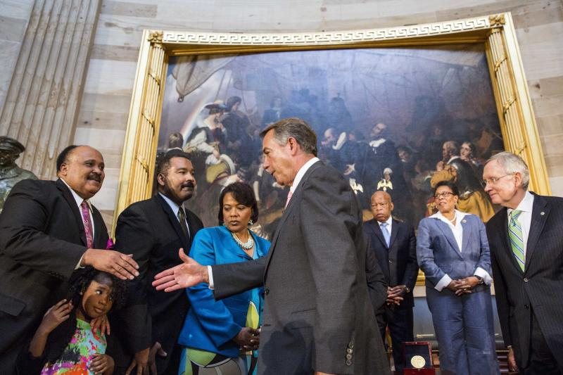 Speaker of the House John Boehner (C) shakes the hand of Martin Luther King III (L), son of Dr. Martin Luther King, Jr. in Washington, DC on June 24, 2014 (AFP Photo/Drew Angerer)