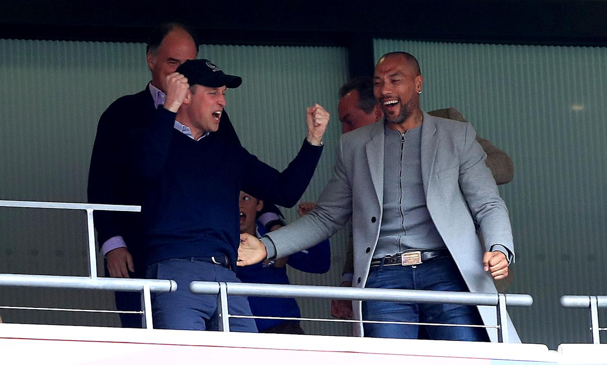 The Duke of Cambridge (left) celebrates in the stands with former footballer John Carew (right) after Aston Villa's Anwar El Ghazi scores his side's first goal of the game during the Sky Bet Championship Play-off final at Wembley Stadium, London.