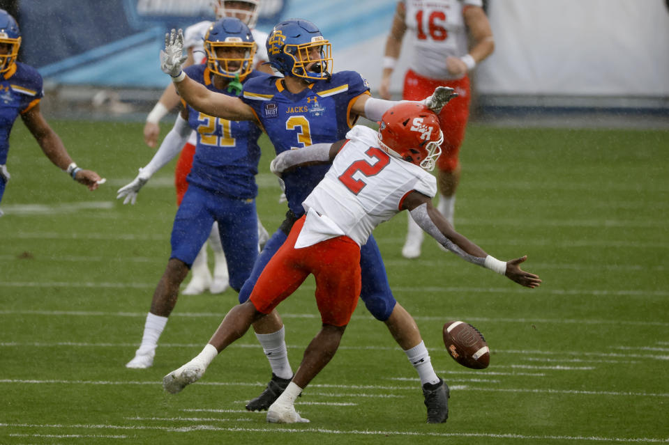 South Dakota State safety Joshua Manchigiah (3) defends on an incomplete pass to Sam Houston State wide receiver Ife Adeyi (2) during the first half of the NCAA college FCS Football Championship in Frisco, Texas, Sunday, May 16, 2021. (AP Photo/Michael Ainsworth)