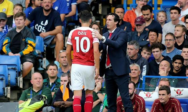 <span>Unai Emery took Mesut Özil off after 68 minutes during last week's defeat at Chelsea.</span> <span>Photograph: TGSPhoto/Rex/Shutterstock</span>