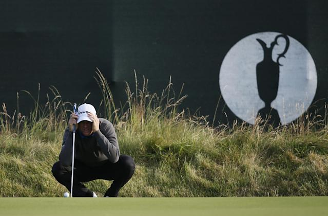 Robert Karlsson of Sweden lines up a putt on the 3rd green during the first day of the British Open Golf championship at the Royal Liverpool golf club, Hoylake, England, Thursday July 17, 2014. (AP Photo/Alastair Grant)