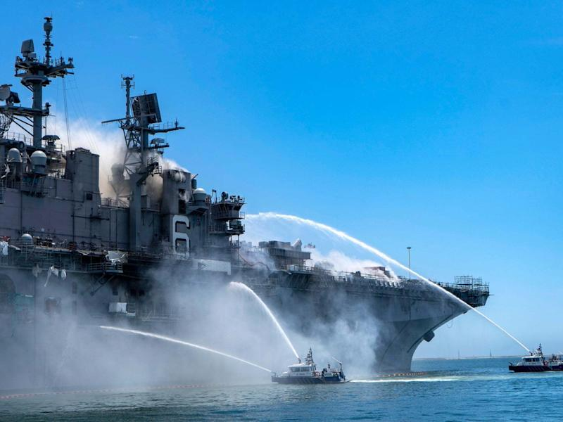 USS Bonhomme Richard at Naval Base San Diego, on fire on Sunday: EPA