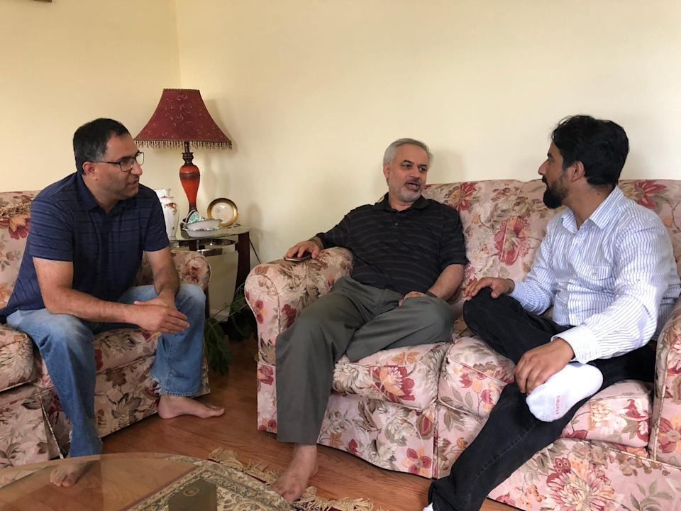 Tahir Qazi (middle) chats with friends, Arif Jan (left) and Shuaib Nabi (right) during Ramadan 2019.